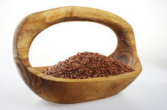Flaxseed in a wooden bowl. Royalty Free Stock Photography