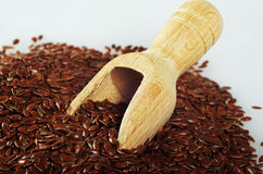 Flaxseed with a wooden spoon. Stock Image