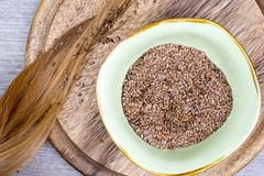 Flaxseeds with blonde hair Royalty Free Stock Images