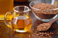 Flaxseeds and linseed oil. royalty free stock image