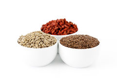 Flaxseeds, sunflower seeds and goji berries Royalty Free Stock Photos