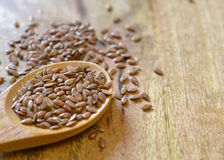Flaxseeds in wooden spoon Royalty Free Stock Photo