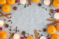 Christmas flat lay frame of oranges, candles, and spices stock image