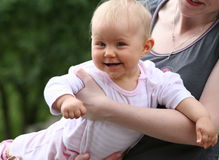 Flaying baby. Very happy baby in pink Stock Photos