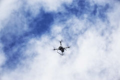 A flaying drone. On blue sky Royalty Free Stock Photo
