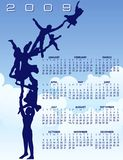 Flaying Family 2009 calendar. A blue and white 2009 yearly calendar with a family flying around Royalty Free Stock Photography
