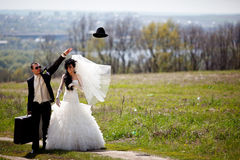Flaying hat. An image of couple on a rural road Royalty Free Stock Photo