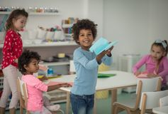 Flaying and take your dream. Children in kindergarten stock photo