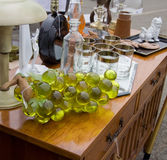 Flea market. Table with glass grape and different kind glass items at flea market stock images