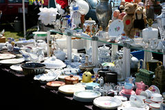 Flea market booth. With different dish ware on a spring flea market in bright sunshine stock photography