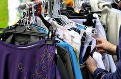 Flea market. Clothes on a rack in a flea market royalty free stock image