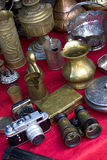 Flea market details. Camera, binoculars and different metallic objects for sale at the flea market Stock Photography