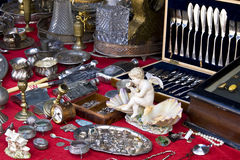 Flea market details. Cutlery, rings, drinking flasks and plenty of other stuff for sale at a flea market stock photography
