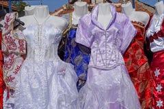 Flea market dresses. Second hand festive dresses at flea market Stock Photography