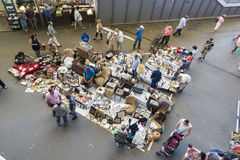 Flea market, Els Encants Vells, Barcelona. Barcelona, Spain - June 18, 2014: Several sellers at their posts of objects, antiques, and furniture resale while royalty free stock photos