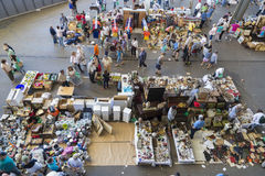 Flea market, Els Encants Vells, Barcelona. Barcelona, Spain - June 18, 2014: Several sellers at their posts of objects, antiques, and furniture resale while royalty free stock photo
