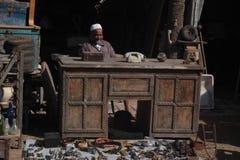 Flea market in Essaouira. The old man who looks like a big boss in flea market in Marocco royalty free stock photography