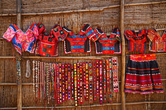Flea market in India. Colorful gypsy style clothing are shown on a wall of the street shop at the flea market in India stock photo