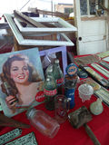 Flea Market Items for Sale. Items for sale at the outdoor Raleigh, North Carolina Flea Market, including Coca-Cola bottles, Gulf, glasses, frames, an old door royalty free stock photos