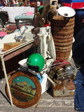 Flea Market Items for Sale. Items for sale at an outdoor Raleigh, North Carolina Flea Market—including golf clubs, wooden buckets, a green helmet and a royalty free stock image