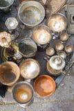 Flea market jugs. Flea market silverware jugs and pots Royalty Free Stock Photography