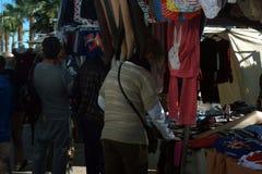 Flea market. Market of cheap goods. Market during week-end. Market of the day off. Flea market. Buyers in flea market Stock Image