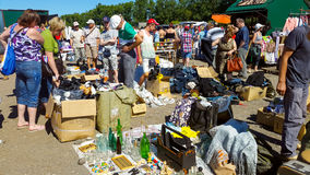 Flea market. MOSCOW - JULY 04: People buy and sell used items at a flea market Levsha at Novopodrezkovo on July,4 2015 in Moscow Stock Image