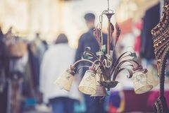 Flea market: Old fashioned lamp in the foreground, people in the blurry background. Old fashioned lamp on a flea market, people in the blurry background sale royalty free stock image