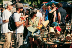 Flea market with people choosing vintage furniture Royalty Free Stock Photography