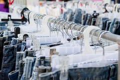 Flea market sale jeans Royalty Free Stock Photo