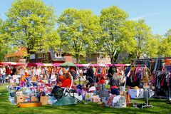 April 2017, Flea market secondhand Kingsday (Koningsdag) , Netherlands. Vrijmarkt outdoor flea market with secondhand toys, games and other stuff at stock photo
