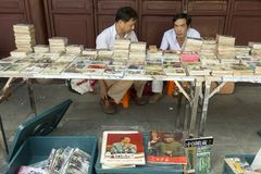 Flea market in Shanghai, China. At the flea market in Shanghai China people sell old books, photo novels and items connected with cultur revolution. Culture Stock Images