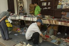 Flea market in Shanghai, China. At the flea market in Shanghai China people sell old books, photo novels and items connected with cultur revolution. Culture Stock Image