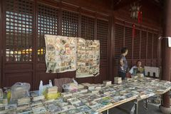Flea market in Shanghai, China. At the flea market in Shanghai China people sell old books, photo novels and items connected with cultur revolution. Culture Royalty Free Stock Image