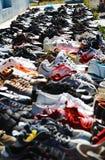 Flea Market Shoes. Bunch of shoes at a flea market stock photos