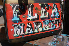 Flea market. Sign painted on a suitcase stock photos