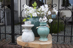 Flea market still life with stone vases Stock Photo