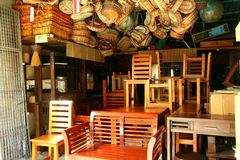 Flea market store near Dapitan Arcade in Manila, Philippines selling wooden furniture. Royalty Free Stock Photos