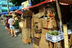 Flea market stores near Dapitan Arcade in Manila, Philippines selling woven baskets. Royalty Free Stock Image