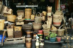 Flea market stores near Dapitan Arcade in Manila, Philippines selling woven baskets. Royalty Free Stock Photos