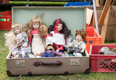 Flea market. A Suitcase with old dolls Royalty Free Stock Photos