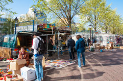 Daily Flea market on Waterlooplein (Waterloo Square), merchants display their bric-a-brac for sale. Royalty Free Stock Images