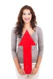 Flecha de la mujer para arriba fotografía de archivo