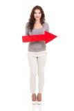 Flecha de la mujer que señala a la derecha Imagenes de archivo