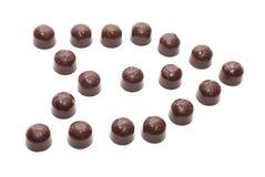 Flecha de los caramelos del chocolate con leche fotos de archivo libres de regalías