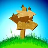 Flecha de madera con los pájaros Foto de archivo
