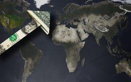 Flecha del dólar en un mapa del mundo Imagen de archivo libre de regalías