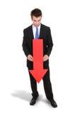 Flecha del hombre de negocios abajo Foto de archivo libre de regalías