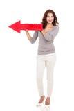 Flecha del rojo de la mujer imagen de archivo libre de regalías
