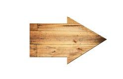 Flecha direccional hecha de vieja superficie de madera imagenes de archivo